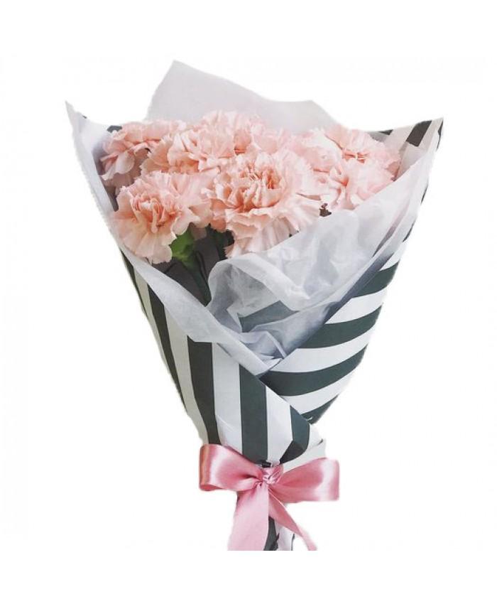 Букет из 7 розовых гвоздик